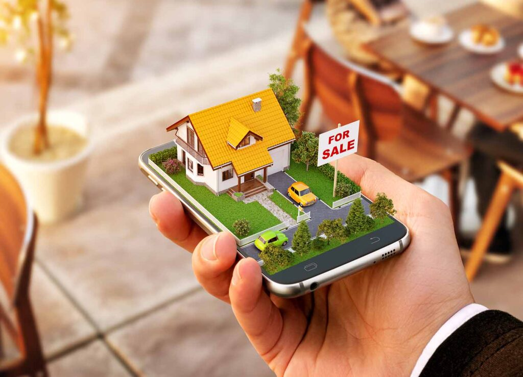 Mobiltelefon med et lite hus og hag med til salgs skilt